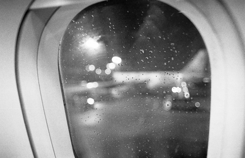Analog photo, ISO 400, pushed 1600, inside a plane in Hamburg before takeoff.
